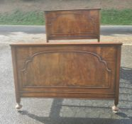Early to mid-20th century walnut bed, both the headboard and footboard with arched decoration with