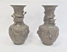 Pair Chinese bronze vases, baluster-shaped and each embossed with pair dragons and flaming pearl and