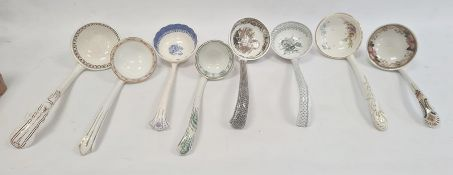 Quantity of Victorian and later pottery soup ladles, variously decorated (1 box)