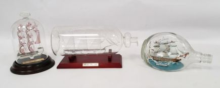 Glass ship in bottle, two further bottles with ships (3)