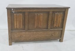 20th century oak blanket box, the rectangular top above the linenfold decorated front, single drawer