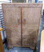 1930/1940's limed oak compactum with carved floral and scroll frieze over two doors with chrome