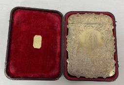 A Victorian silver card case, engraved decoration of scrolls surrounding putti, waterfall and