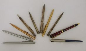 Assorted white metal propelling pencils and pens, etc