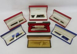 Assorted fountain pens including Sheaffer and Waterman and a Hohner Super Chromonica chromatic
