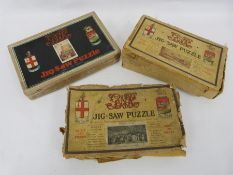 Three boxes of wooden jigsaw puzzles and a lace tray cloth
