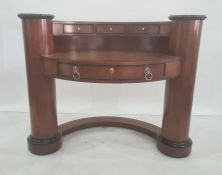 Modern dressing table of curved form, with three short drawers above the bowfront, the top above