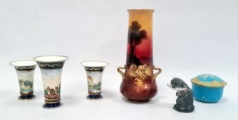 Garniture of three English porcelain blue ground spill vases, circa 1820 painted with a continuous