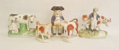 19th century collection of Staffordshire pottery comprising a Toby jug, 21.5cm high, a farmer with