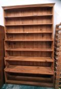 Large pine waterfall bookcaseof seven shelves, moulded cornice, plinth base, 140cm x 223cm
