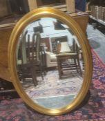 Modern oval mirrorin gilt-effect moulded frame, 81cm x 60cm