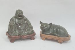 Bronze effect seated buddha on stand and similar lying cat, green patinated finish