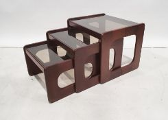 Mid-century nest of three tableswith smoked glass tops