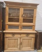 Possibly continental pine dresser, the two glazed doors above two opaque glass doors, the base of