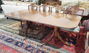 Regency style mahogany dining table with reeded edges, pedestal support, extended 211cm x 96cm wide