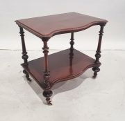 Victorian mahogany serpentine-fronted two-tier etagereon turned, fluted and carved supports, turned