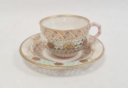 Royal Worcester porcelain reticulated cabinet cup and saucer with gilt landscape and jewelled