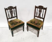Pair of 19th century low chairswith carved and pierced backsplats, overstuffed seats, turned