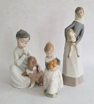 Lladro porcelain groupof boy in nightshirt with puppy, 20cm high, Lladro girlwith lamb and another
