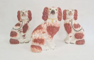 Pair of Staffordshire pottery models of spaniels, 22cm high, and another similar, circa 1880, each
