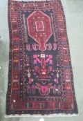 Rich ground heavily piled Iranian village rug, 296 x 152cm