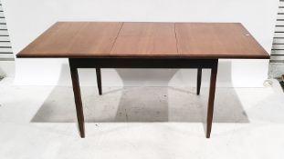 Mid century White & Newton teak extending dining tableof rectangular form, on square section