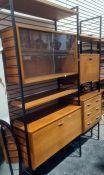 Ladderax lounge unitconsisting three uprights, sliding glass unit, three drawer unit, secretaire