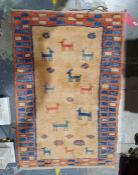 Modern Eastern-style rug, yellow ground decorated with animals, in peach and blue border, 144cm x