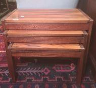 Mid-century nest of three probably Santos Palisander wood coffee tables