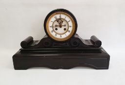Victorian black slate mantel clock, drum-shaped movement, on scroll and shaped plinth base, with
