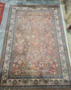 Modern peach ground rug, allover foliate decoration, cream ground border, 292cm x 200cm