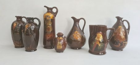 """A collection of seven Royal Doulton warescomprising a Kingsware """"Watchman"""" tall jug, 27cm high,a"""