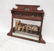 Late 19th/early 20th century mahogany overmantel mirror, the rectangular plate with bevel edge,