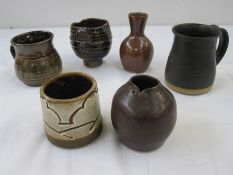 Winchcombe pottery brown glazed miniature vase, marked to base, two studio pottery tankards and