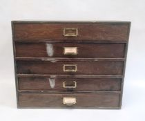Five-drawer table-top cabinet containing watch springs, parts and clock faces, etc