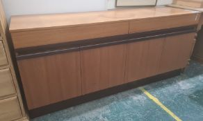 Possibly 1980's G-Plan teak sideboard, the rectangular top above two drawers and four cupboard
