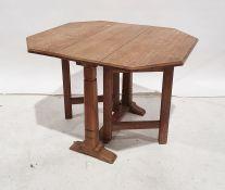 Oak Cotswold School-style gateleg coffee tablewith octagonal cross-cut oak top (when extended) on