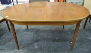 1970's G-Plan style teak extendingdining table of oval form on tapering circular supports, 112 x