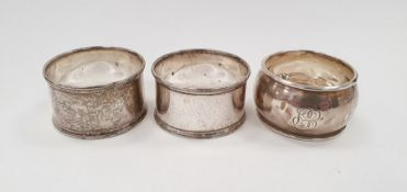 Silver napkin ring and a pair of silver plated napkin rings