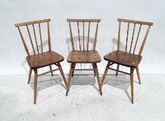 Set of three Ercol elm seated beech-framed stickback chairs(3)