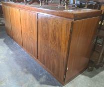 Skovby figured teak sideboard, the rectangular top above four doors (no interior fittings), on