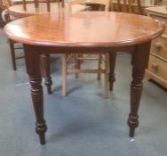 20th century circular tablewandoo wood table and four jarrah turned supports, peg feet, 104cm