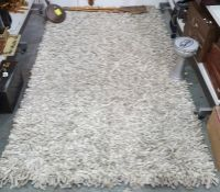 Modern cream ground rectangular rug, 255cm x 152cm