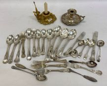 A quantity of silver plated flatware, teaspoons, a silver plated chamberstick and another gilt