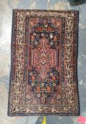 Eastern rug, dark blue ground with central peach ground medallion, foliate decorated field, multi-