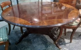 20th century mahogany andstrung circular dining table, ogee mouldedge, on four turned column