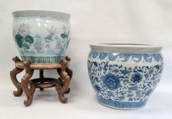 Two Chinese porcelain jardinieres, 20th century, the first decorated in blue in the Ming style