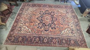 Eastern rug, pink ground with central foliate medallion, field foliately decorated, cream ground