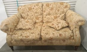Modern three piece suitecomprising a two seater sofa and two armchairs in brown floral
