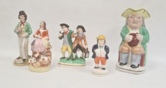 Collection of Staffordshire pottery figures, circa 1880, including a Toby jug, 24cm high overall,
